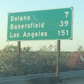 Highway sign shows 151 miles until Los Angeles