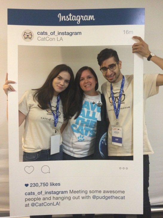 Three people pose with @cats_of_instagram sign