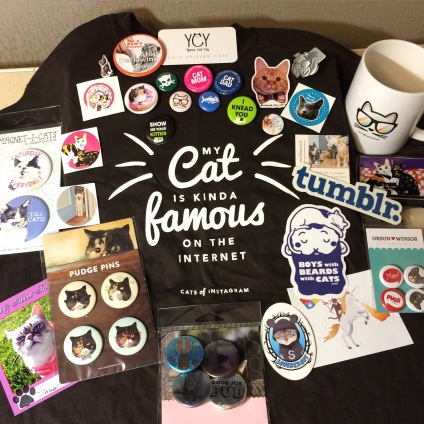 "Collection of cat-related products, including tee-shirt that reads ""My cat is kinda famous on the internet"""