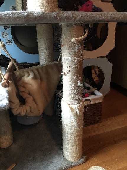 Photo of cat tree leg with most of the damaged rope removed.
